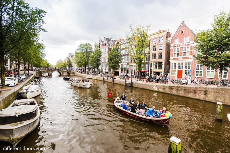 Amsterdam, canals, boats, flag, bridges